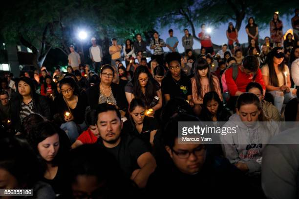 Students hold a moment of silence for the victims of the mass shootings that killed 59 people and injured more than 525, in Las Vegas, Nevada, on...
