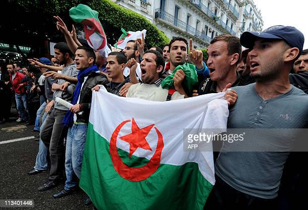 Students hold an Algerian flag at a protest during which clashes erupted between security forces and students demanding political change leaving at...