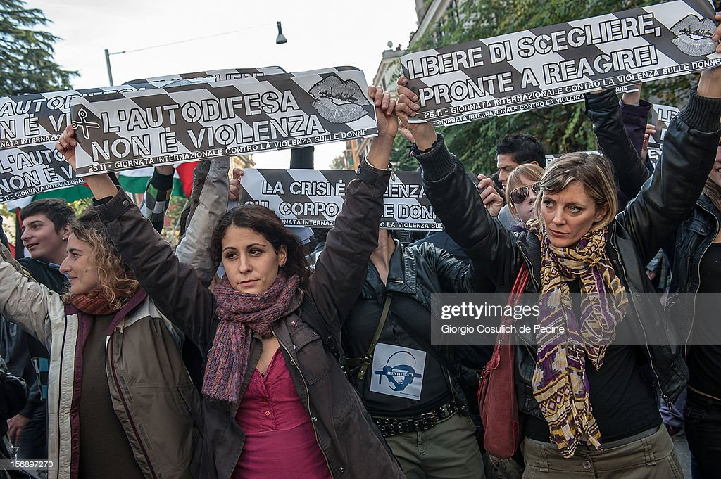 Students hold banners against violence against women as they protest during a national general strike against the austerity policy in Europe on November 24, 2012 in Rome, Italy. Students in Italian cities protested against cuts to the education budget and school reforms in the first major student demonstrations since the beginning of the school year. Demonstrators across Italy have been protesting the austerity measures taken by their government in the wake of the Eurozone's financial crisis.