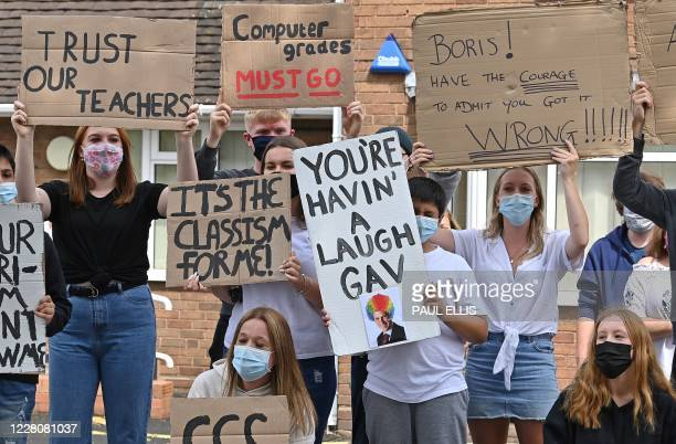 Students hold placards as they take part in a protest march from Codsall Community High School to the constituency office of Gavin Williamson,...