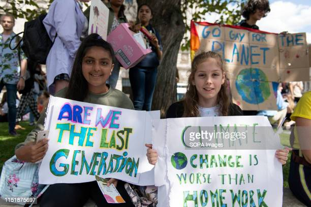 Students hold placards at the Parliament Square during a protest Students gathered at Parliament Square and marched through central London demanding...