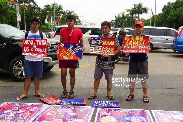 BOULEVARD MANILA PHILIPPINES Students hold placards depicting United States of America and China's fascism during the independence day protest The...
