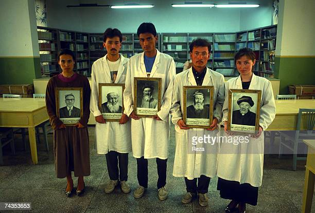 Students hold portraits of former elders on May 1996 in Khotan China