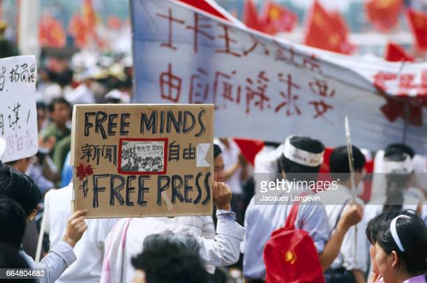 Students hold protest sings during a hunger strike in Beijing's Tiananmen Square In the spring of 1989 students and citizens held massive...