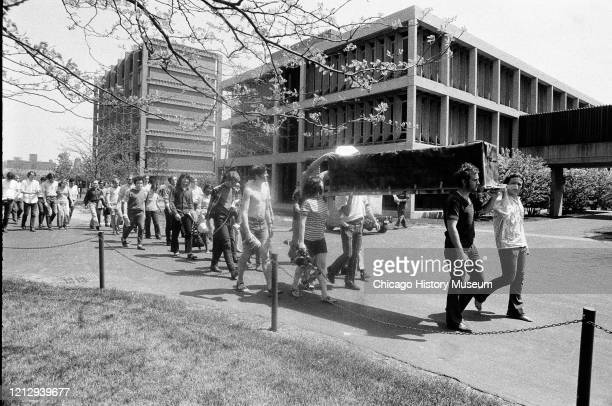 Students hold rally in the outdoor amphitheater at Northwestern University and carry mock coffins representing the 4 dead from the Kent State...