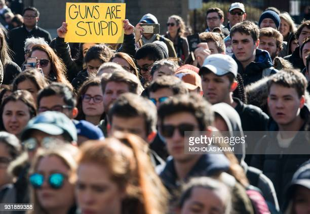 Students hold signs at Georgetown University in Washington DC on March 14 2018 during a national walkout to protest gun violence one month after the...
