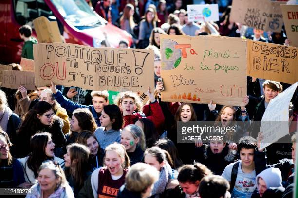 Students hold signs reading politician you have to move or we will move you as they take part in a 'Youth For Climate' march on February 14 2019 in...