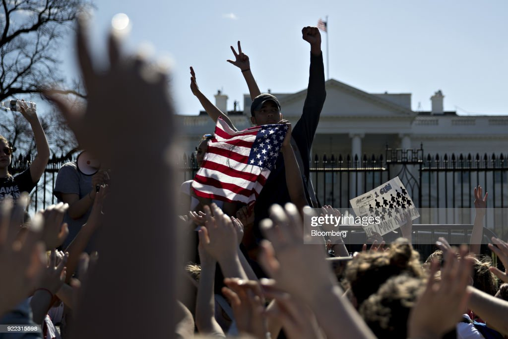 Students hold their hands up during a moment of silence while reading the names of victims from last weeks high school mass shooting outside the White House in Washington, D.C., U.S., on Wednesday, Feb. 21, 2018. President Donald Trump is meeting with students, parents and teachers who have lived through mass shooting incidents, including some from the Florida high school where last weeks mass shooting killed 17 people. Photographer: Andrew Harrer/Bloomberg via Getty Images