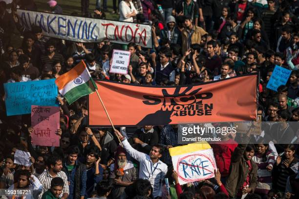 Students hold up placards as they chant slogans in front of a Police cordon during a protest against the Indian governments reaction to recent rape...