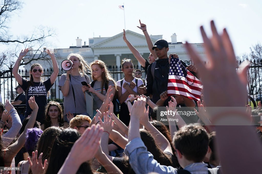 Students hold up their hands as they participate in a protest against gun violence February 21, 2018 outside the White House in Washington, DC. Hundreds of students from a number of Maryland and DC schools walked out of their classrooms and made a trip to the U.S. Capitol and the White House to call for gun legislation, one week after 17 were killed in the latest mass school shooting at Marjory Stoneman Douglas High School in Parkland, Florida.