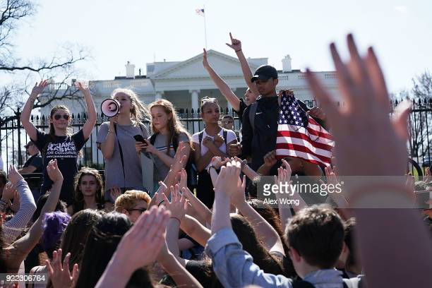Students hold up their hands as they participate in a protest against gun violence February 21 2018 outside the White House in Washington DC Hundreds...