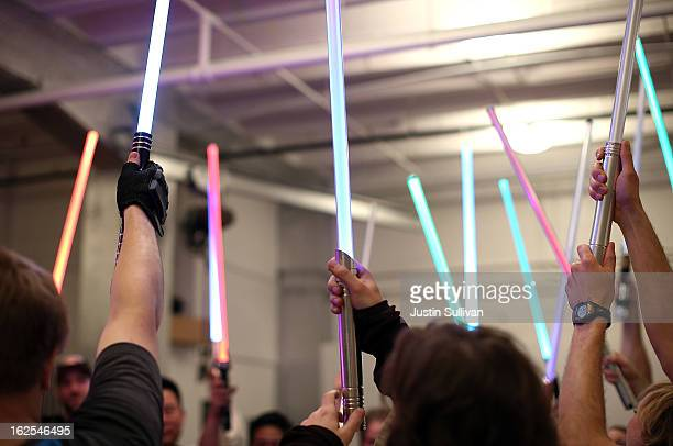 Students hold up their lightsabers during a Golden Gate Knights class in saber choreography on February 24, 2013 in San Francisco, California. Star...