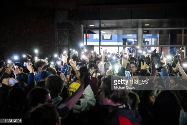 Students hold up their phones after leaving a candlelight vigil at Highlands Ranch High School on May 8 2019 in Highlands Ranch Colorado One student...
