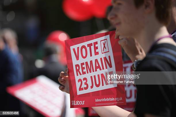 Students hold 'Vote Remain' posters as former Labour leader Ed Miliband campaigns for remain votes while touring with the 'Labour In Battle Bus' at...