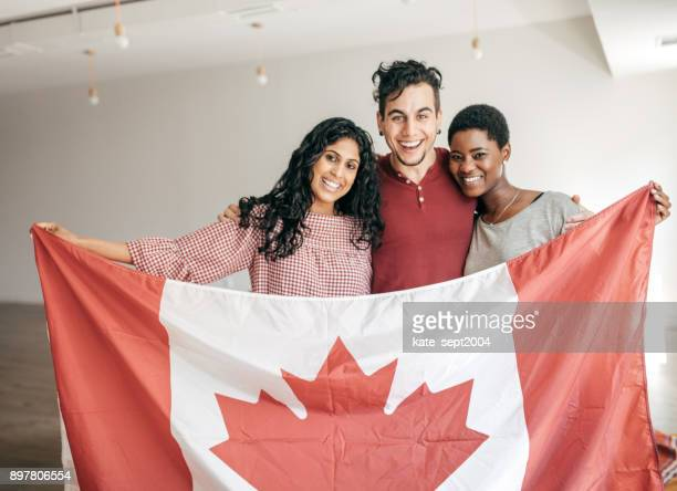 students holding canadian flag - canada day stock pictures, royalty-free photos & images