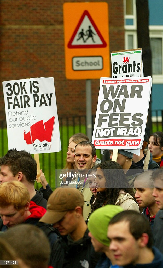 Students holding placards participate in a demonstration December 4, 2002 in London, England. Thousands of students marched through the streets of London to protest against student debt and any increase in fees.