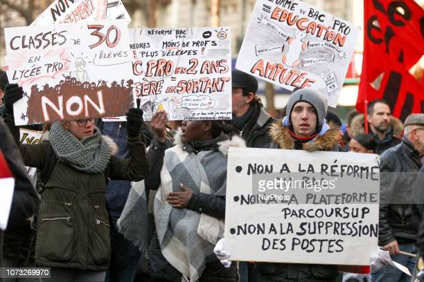Students holding placards take part in a demonstration to the call the CGT Union on December 14 2018 in Paris to call for politcal measures against...