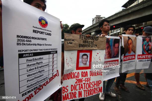 Students holding posters as they march towards Mendiola Bridge Youth groups protest against the alleged human rights violation of the current...