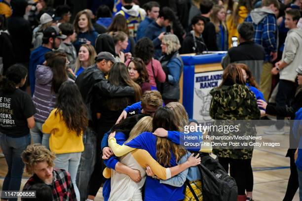 STEM students hug after gathering back in the gym after having left the organized vigil in protest to honor Kendrick Castillo during a vigil in the...