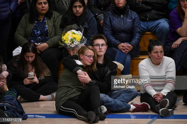 Students hug as Sen Michael Bennet speaks during a candlelight vigil at Highlands Ranch High School on May 8 2019 in Highlands Ranch Colorado One...