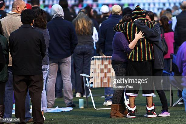 Students hug during a candlelight vigil attended by hundreds at Jonathan Law High School after the death of Maren Sanchez who was stabbed to death...