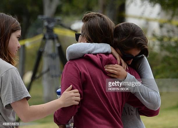 Students hug on May 24 after a driveby shooting in Isla Vista California a beach community next to the University of California Santa Barbara Seven...