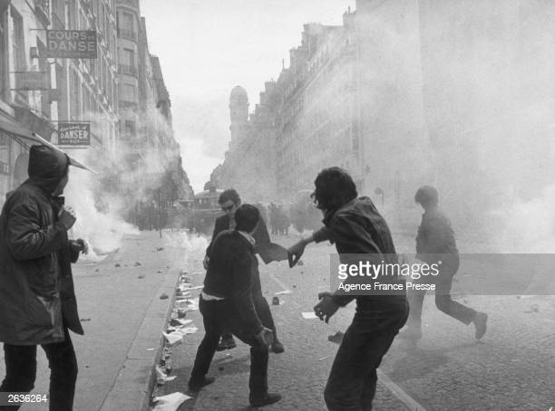 Students hurl paving stones at police in the Rue Saint Jacques in Paris' Latin Quarter during the student riots Police reply with tear gas