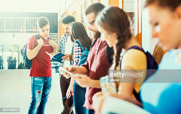 students in a hallway. - high school building stock pictures, royalty-free photos & images