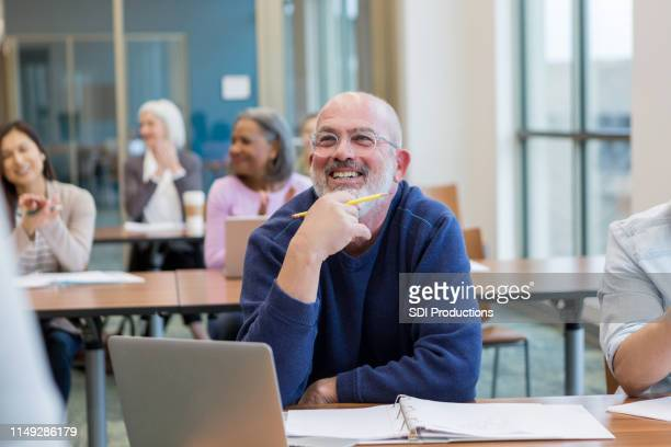 students in adult ed class have fun - adult stock pictures, royalty-free photos & images
