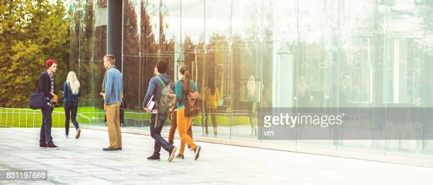 students in campus - university stock pictures, royalty-free photos & images