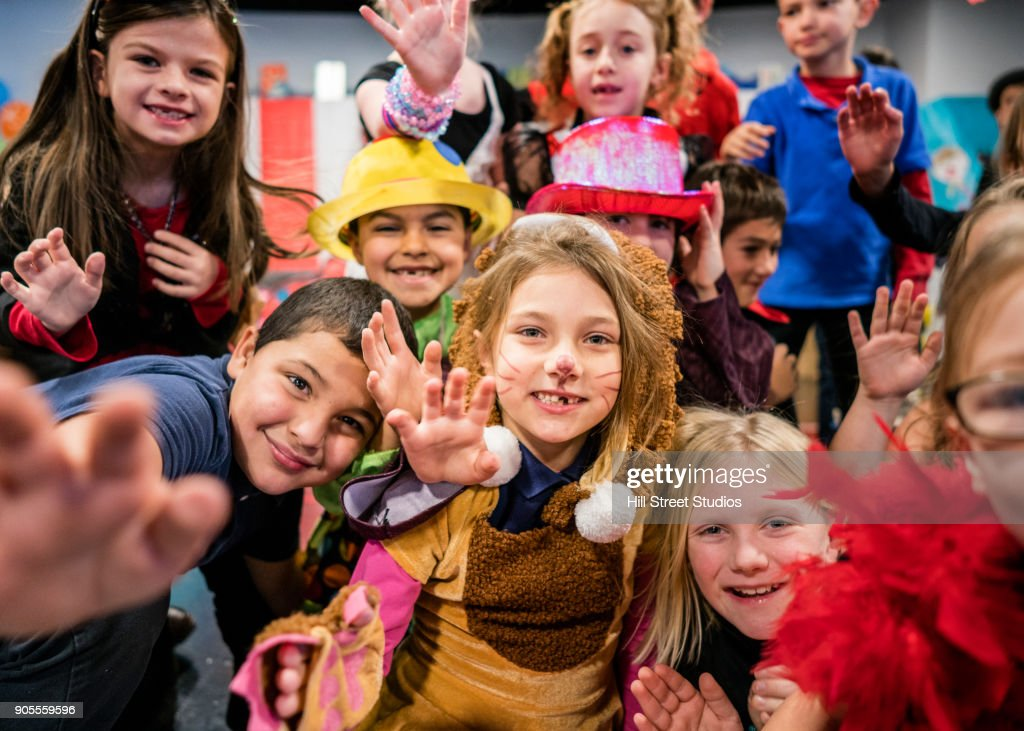 Students in circus costumes performing in theater : Stock Photo