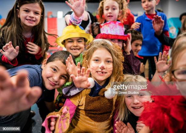 students in circus costumes performing in theater - acting performance stock pictures, royalty-free photos & images