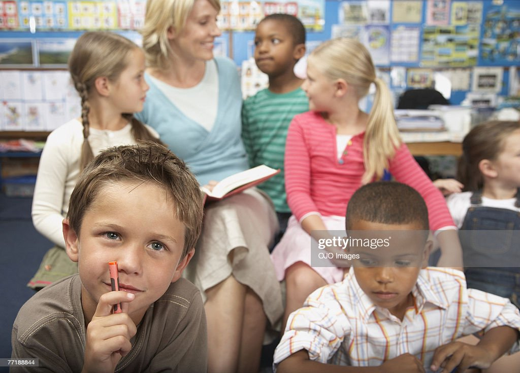Students in class with their teacher : Stock Photo