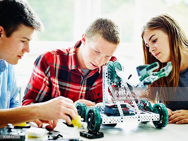 Students in classroom building robot together