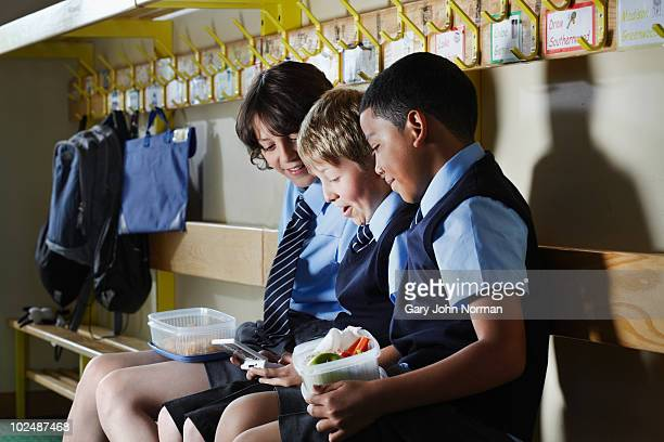 students in cloakroom  - primary age child stock pictures, royalty-free photos & images
