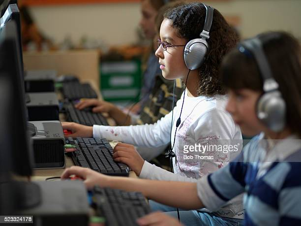 students in computer class - education stock pictures, royalty-free photos & images