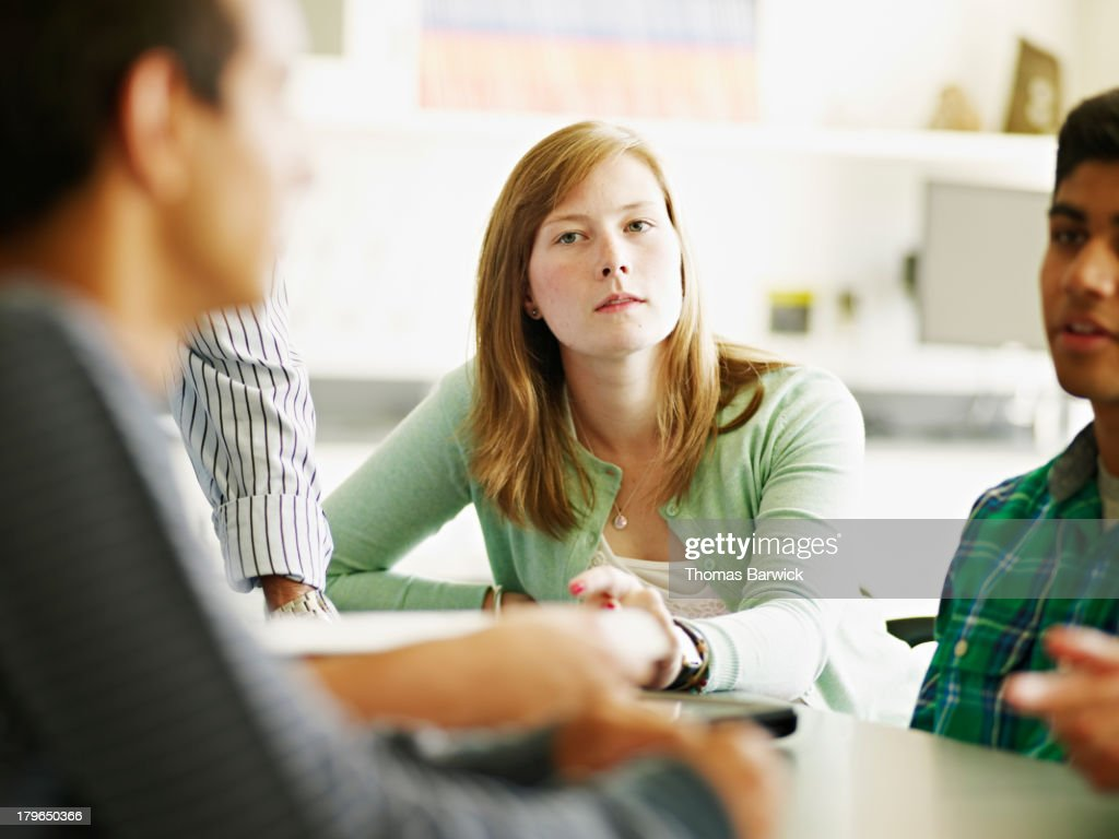 Students in discussion in lab classroom : Stock Photo