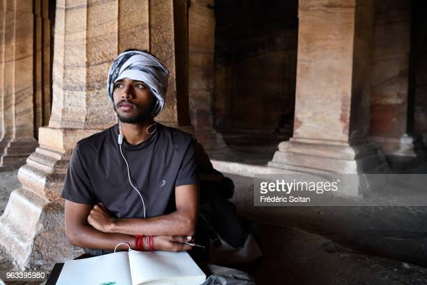 Students in fine arts school in Badami Cave Temples The Badami Cave Temples are composed of four rockcut caves built during the 6th century Sculpture...