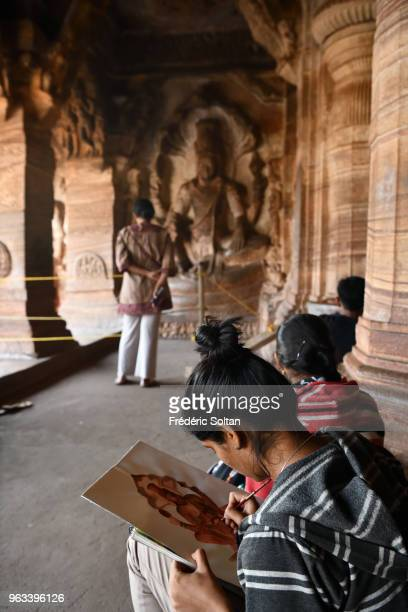Students in fine arts school in Badami Cave Temples. The Badami Cave Temples are composed of four rock-cut caves built during the 6th century....