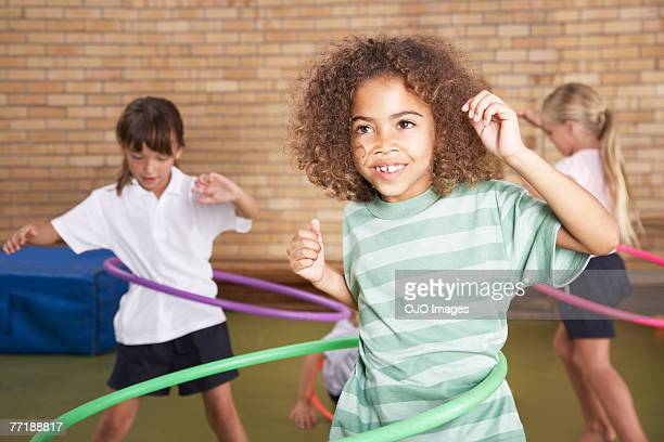 students in gym class - elementary age stock pictures, royalty-free photos & images