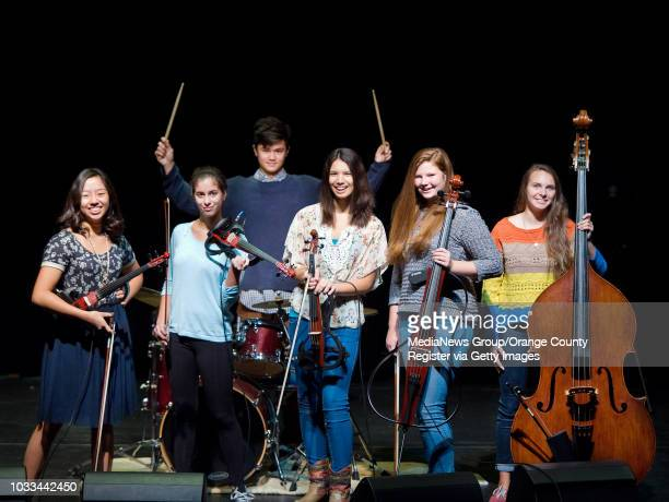 Students in Mission Viejo High School's rock strings program from left: Josephine Kim and Bailey Bregon on violin, Tristan Forseth on drums,...