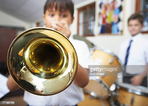 students in music class - trumpet stock photos and pictures