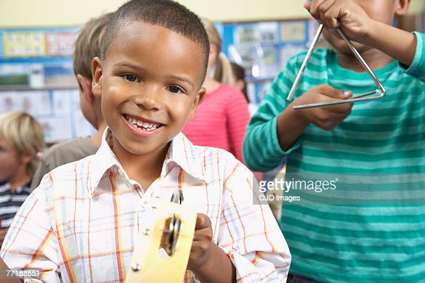 students in music class - triangle percussion instrument stock photos and pictures