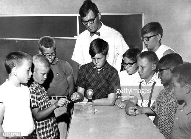 Students in Science Class Gather Around Electrical Experiment Left to Right front row are Rick Meisel Ronnie Bryan Rodger Morie David Schneider Doug...