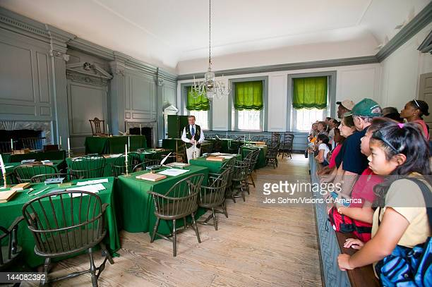 US students in the Assembly Room where Declaration of Independence and US Constitution were signed in Independence Hall Philadelphia Pennsylvania