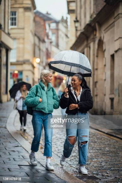 students in the city - cobblestone stock pictures, royalty-free photos & images