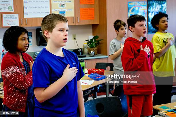 Students in the homeroom of fourth grade teacher Robin Reinhold at Brown Elementary School in South Portland recite the Pledge of Allegiance before...