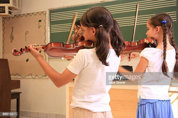 Students in the violin lesson