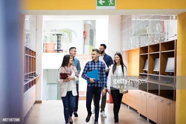 students in university lobby - patio de colegio imagens e fotografias de stock