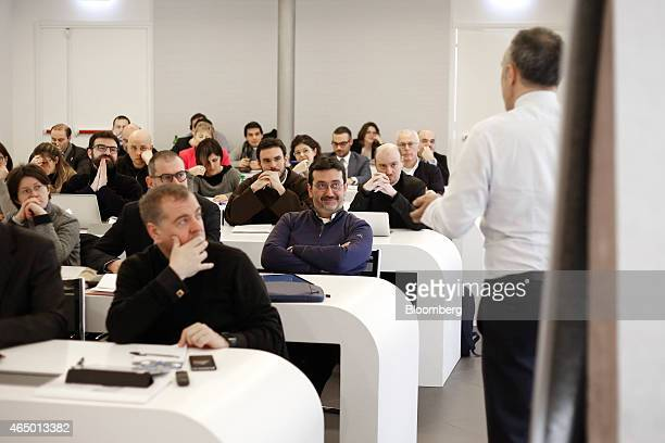 Students including priests and other clerics listen during a pastoral management course designed for those who manage financial and human resources...